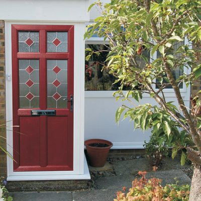 Dark red composite door with stained glass