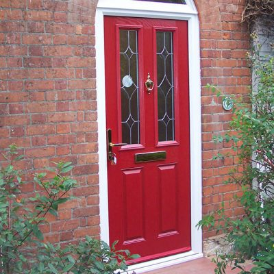 Red composite door with gold hardware