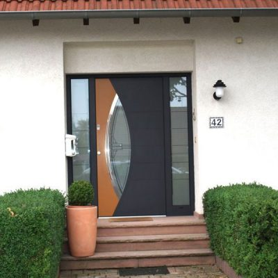 black and timber effect duo-tone composite door