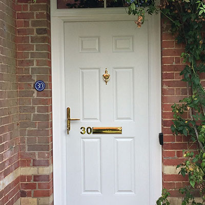 White composite entrance door