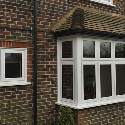White uPVC flush sash casement bay window