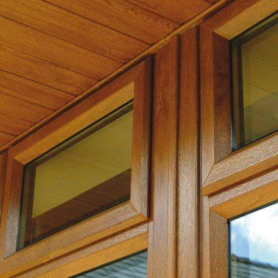 Golden oak casement window closeup