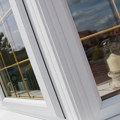 White Casement Windows with Gold Bars